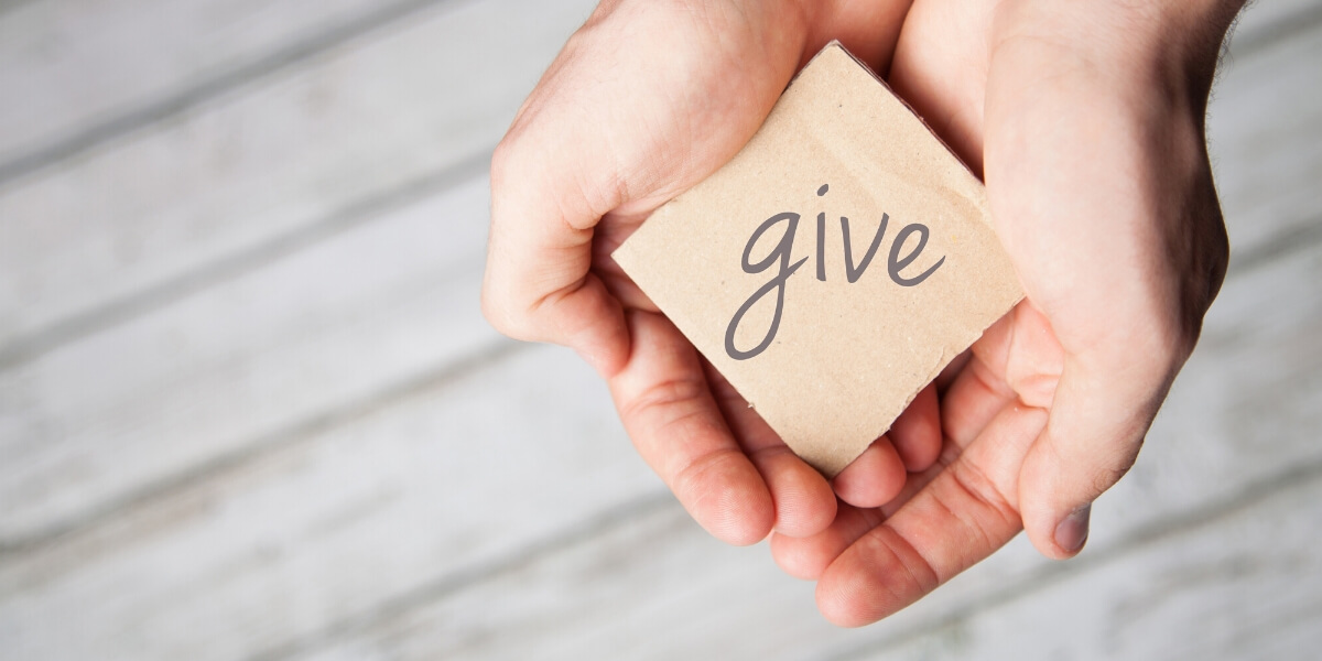 hands with note that says give