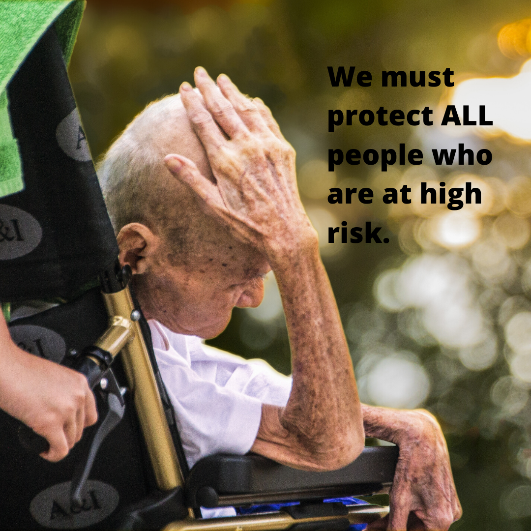 man in wheelchair with head in hand, text says we must protect all who are at high risk